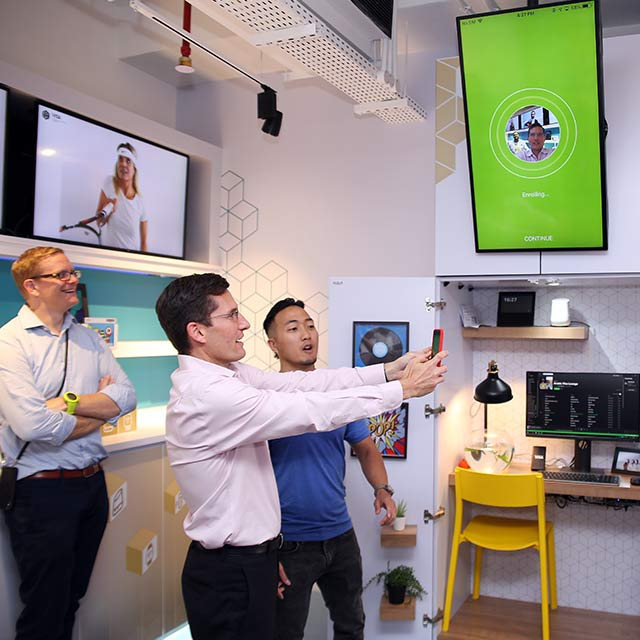 Visa employees at the Dubai Innovation Center test out a new phone app.